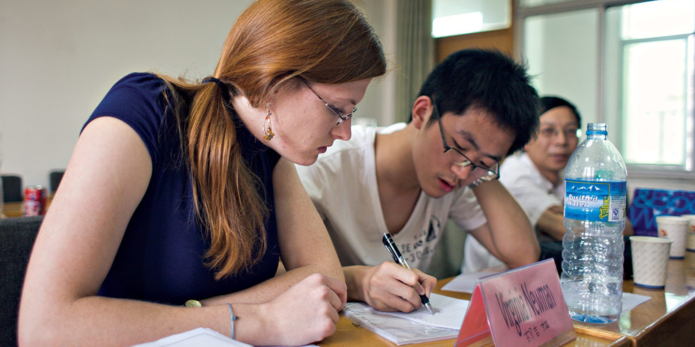 a foreign student taking a one-one-one Chinese tutoring in China