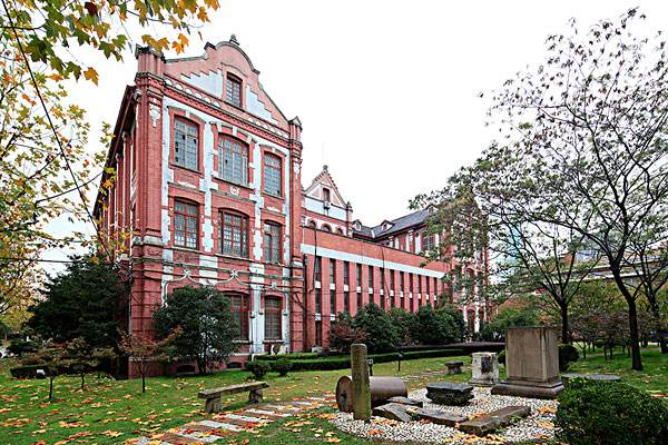 old red-brick building in campus of Shanghai Jiaotong Univeristy