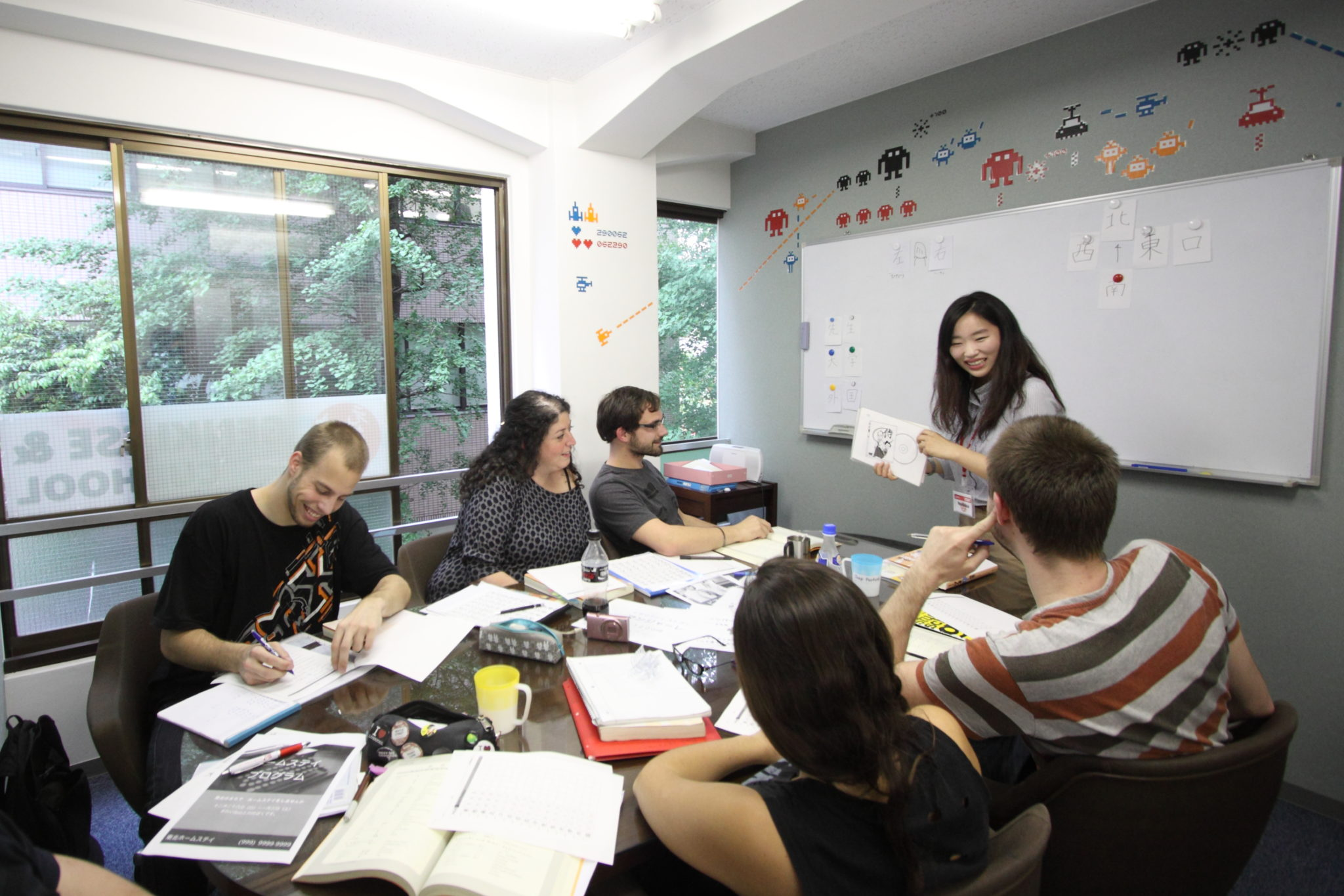 Foreign students taking a small-group Chinese-learning class in China