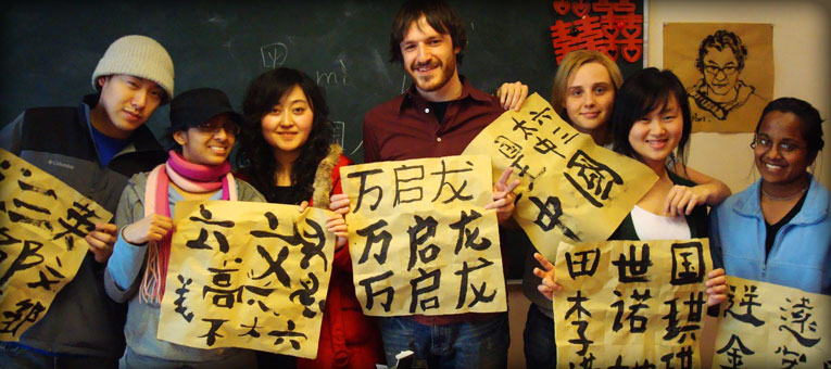 Foreign students taking photos with their Calligrapy works in their hands in China